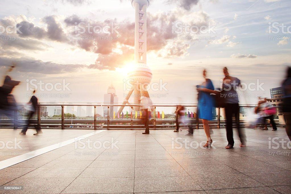 landmark and walking people in Shanghai. stock photo