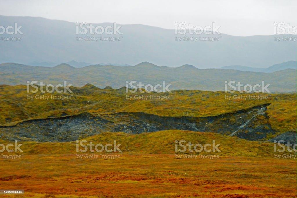 A landmark in Denali National Park where a permanent glacier has melted in the land. stock photo
