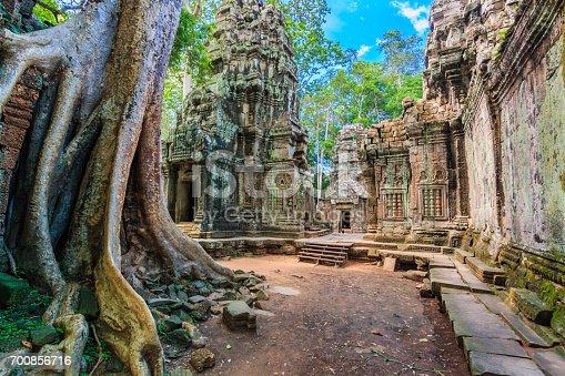 istock Landmark of Cambodia Temple old Landmark Ancient City ancient stone door and tree roots, Ta Prohm temple ruins, Angkor, Cambodia 700856716