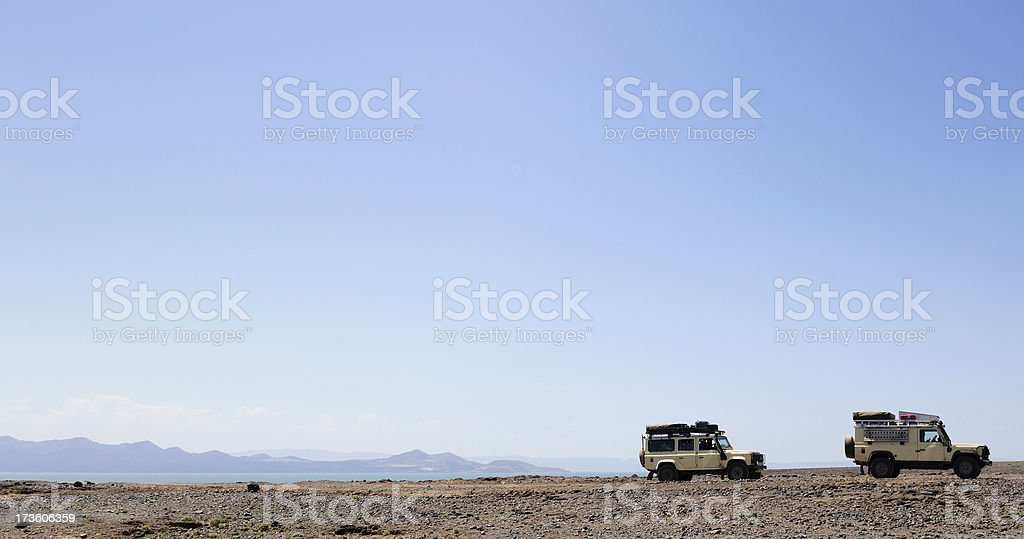 Landrovers in the Desert royalty-free stock photo