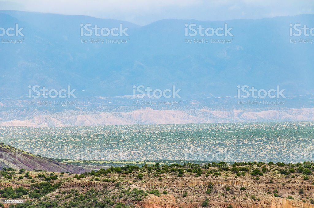 Landscape aerial view of Tsankawi cave dwellings in cliffs stock photo