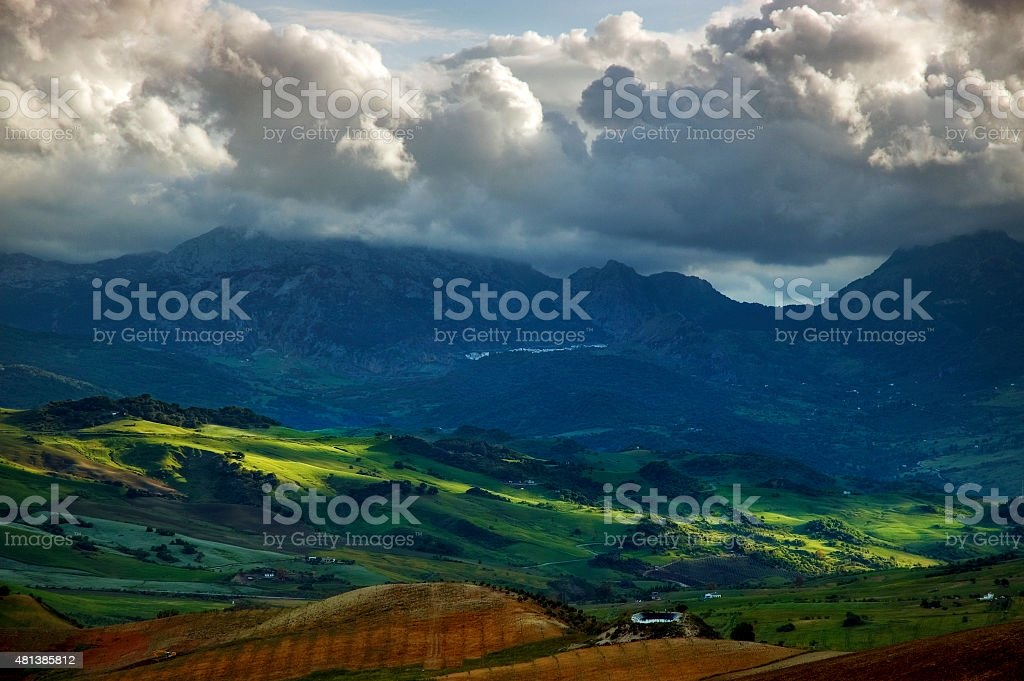Landscape and cloudscape at sunset, Sierra de Grazalema, Andalusia, Spain stock photo