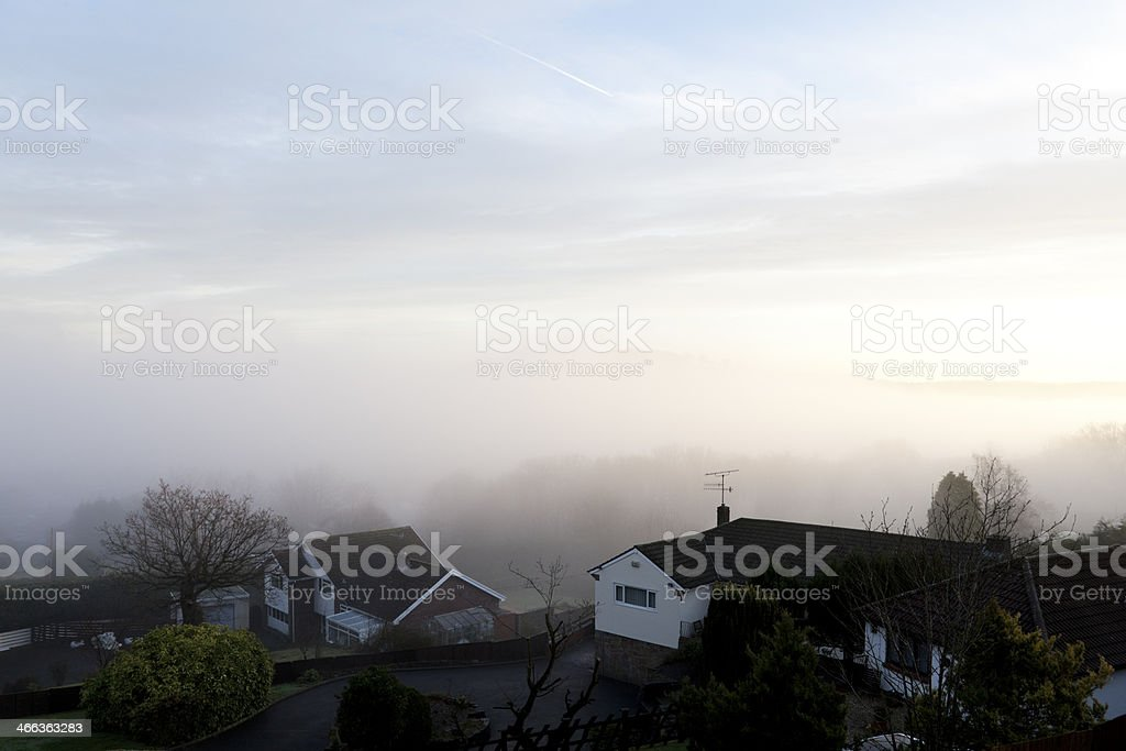 Landscape and Houses in Fog stock photo