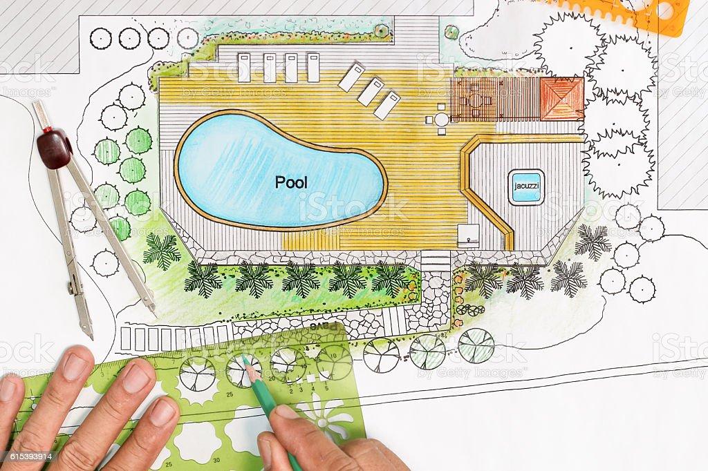 Landscape architect designs backyard plan with Pool stock photo