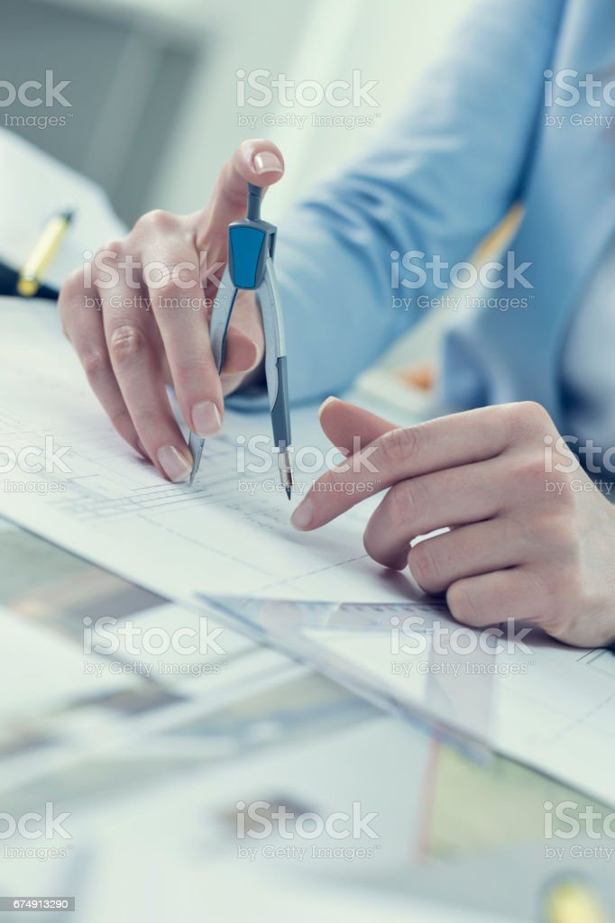 Landscape architect drawing at desk royalty-free stock photo