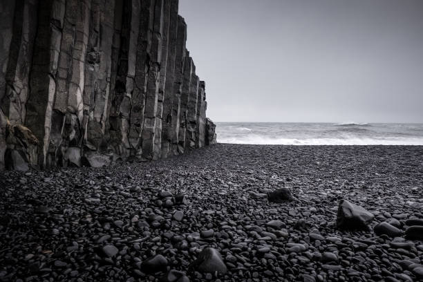 Landscape around black sand beach in Vik, Iceland Black sand beach in Vik is one of the most beautiful beaches on Earth. black sand stock pictures, royalty-free photos & images