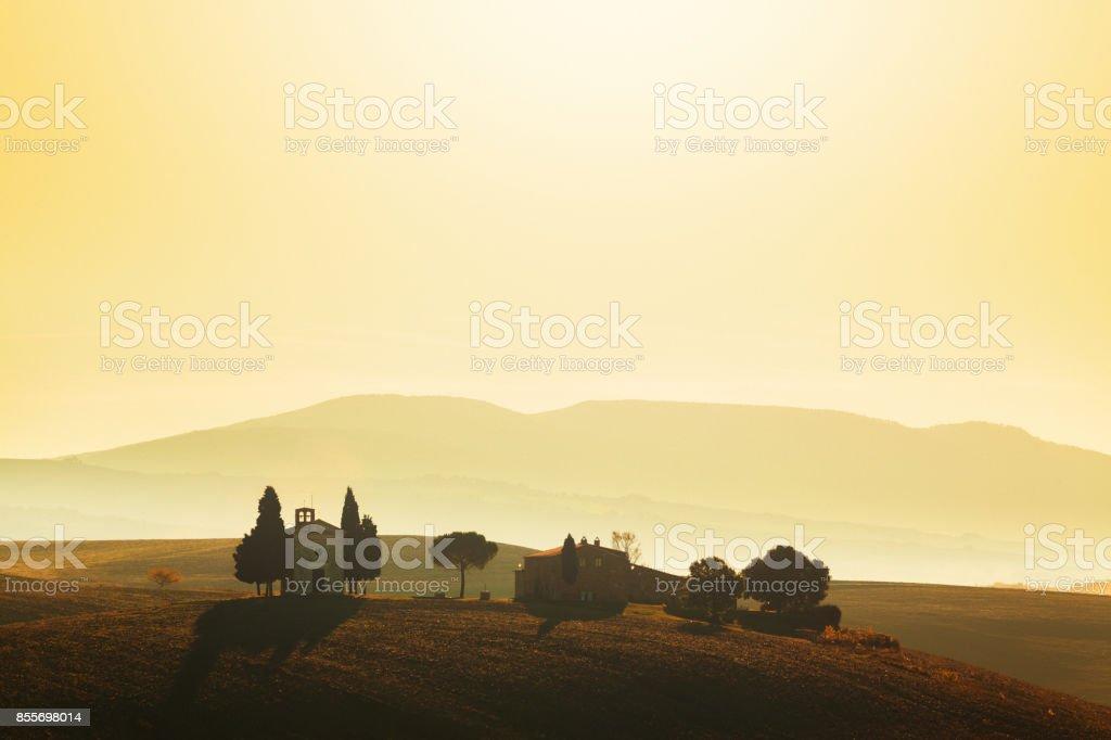Landscape at sunrise in Tuscany (with the Cappella di Vitaleta) stock photo