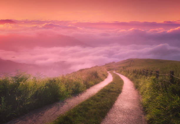 landscape background of morning path on foggy mountains stock photo