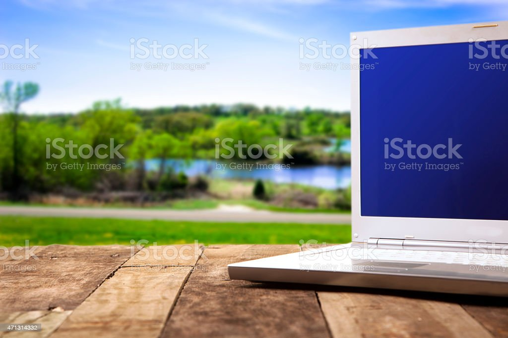Composite image. Rustic, weathered wooden table with a laptop...