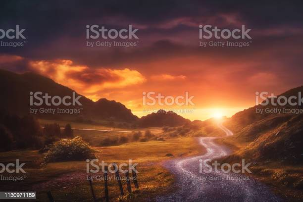 Photo of landscape background with path in Urkiola at sunset