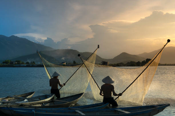 Landscape beautiful. Shadow fishermen at the river in the sunset. stock photo