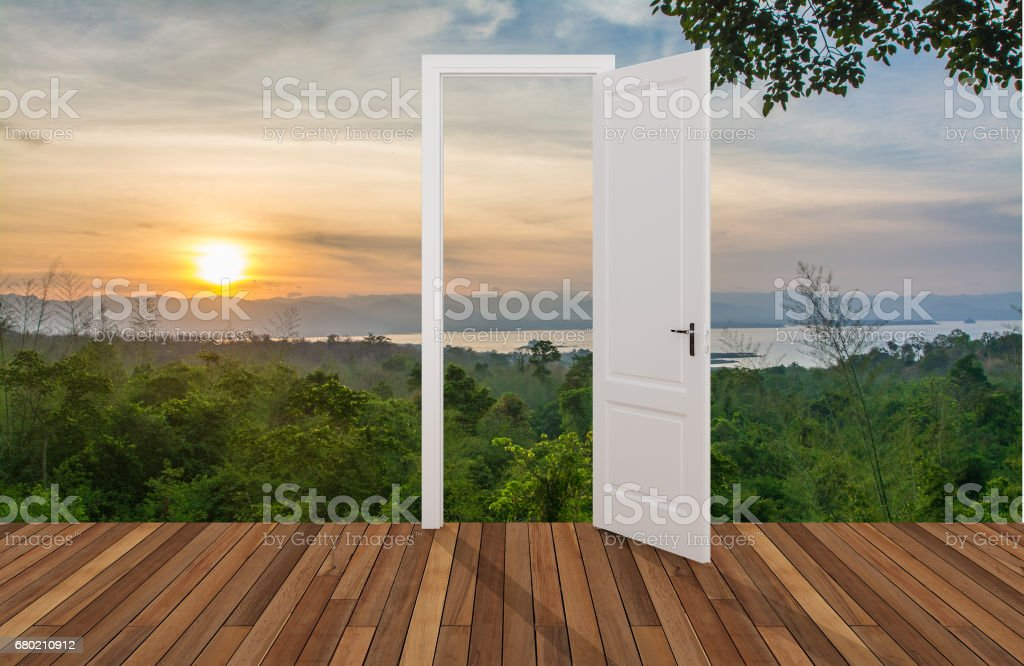 Landscape behind the opening door stock photo