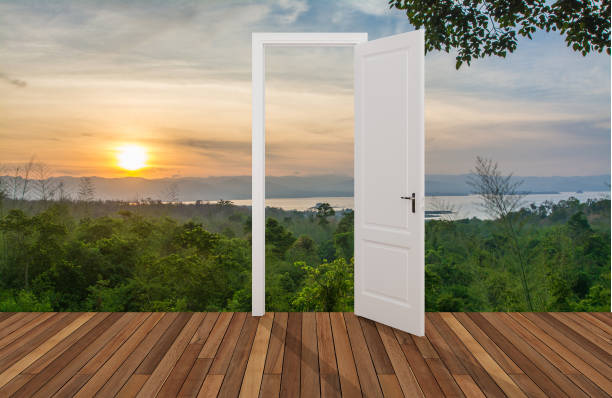 Landscape behind the opening door stock photo