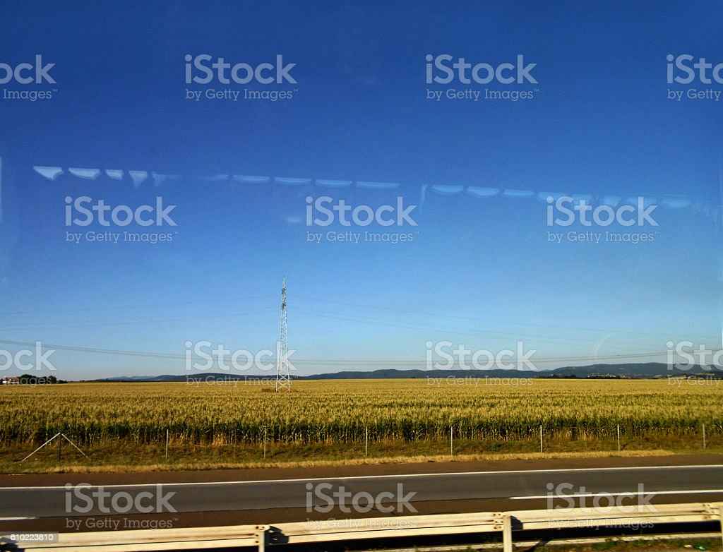 Landscape by the highway thru the bus window stock photo