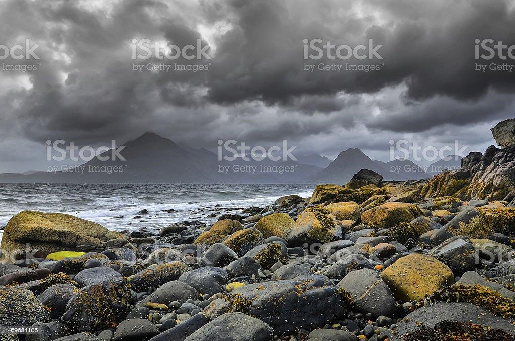 Landscape coastline view of rocks and Cullin hills, Scotland stock photo