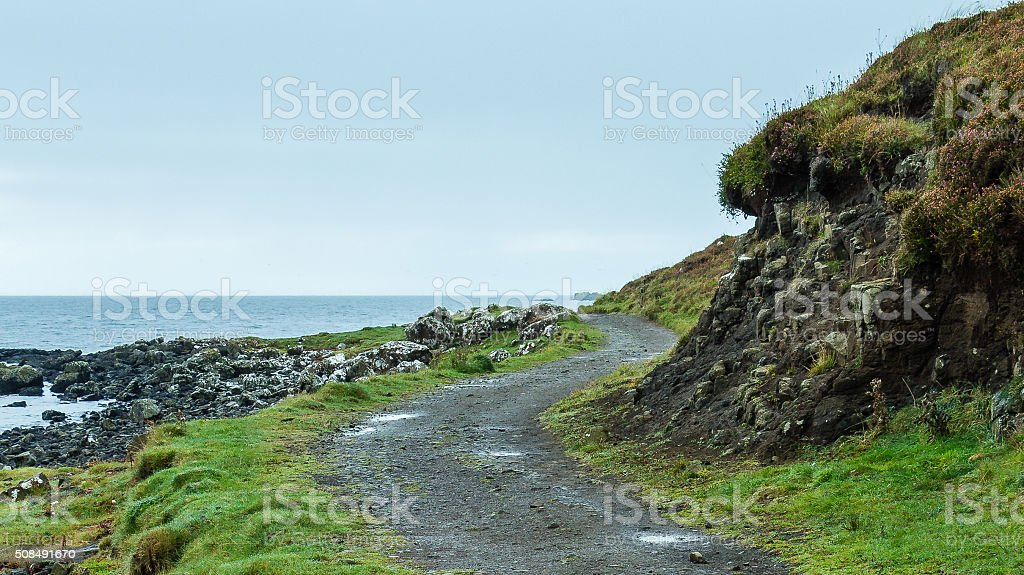 Landscape composition of a windy path beside the coast stock photo