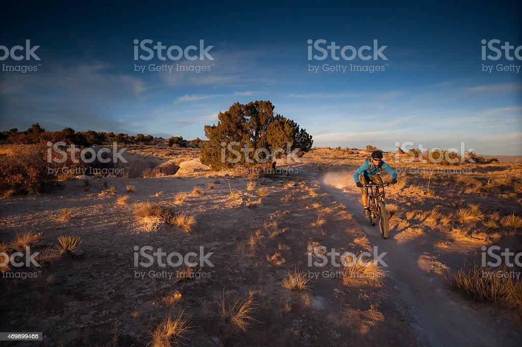 landscape desert man mountain biking stock photo