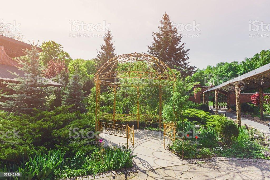 Landscape design, garden path to gazebo royalty-free stock photo