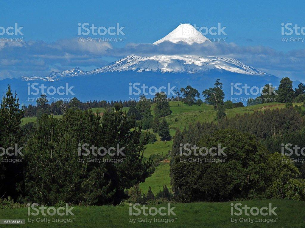 Landscape, field and volcano Osorno, Chile stock photo