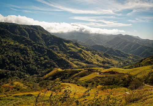Landscape from Monte Verde in Costa Rica, mountains and green forests, rainforest and bue sky with the clouds.