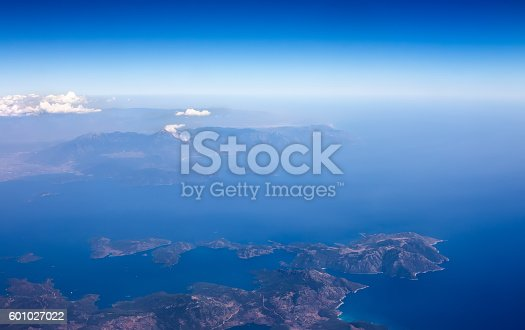 621114928istockphoto Landscape from plane window, show land, sea and clouds. 601027022