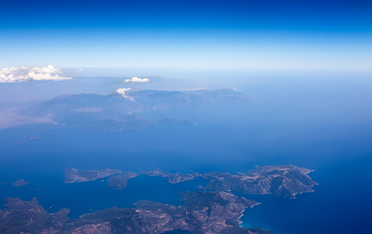 621114928 istock photo Landscape from plane window, show land, sea and clouds. 601027022