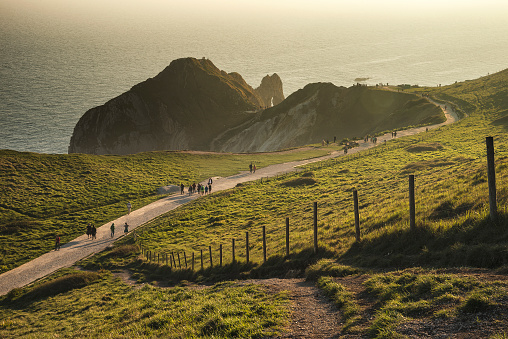 Landscape image of Durdle Door on Jurassic Coast in Dorset during Spring sunset