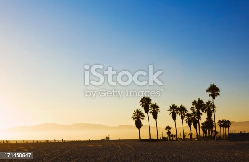 Venice beach at sunset and Santa Monica mountains in the background