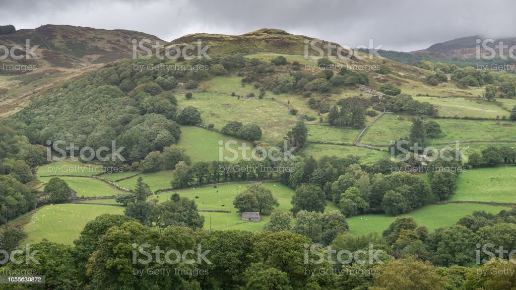 Landscape image of view from Precipice Walk in Snowdonia overlooking Barmouth and Coed-y-Brenin forest during rainy afternoon in September stock photo