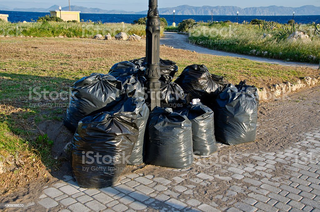 Landscape in Greece with plastic trash bags and seascape stock photo