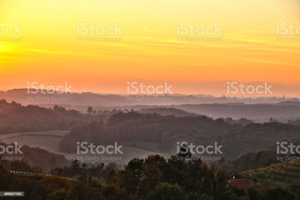 Landscape in the sunlight and mist stock photo