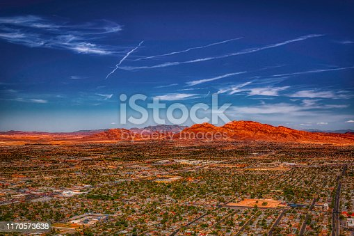 Aerial view of Las Vegas houses in the valley and mountains in the background