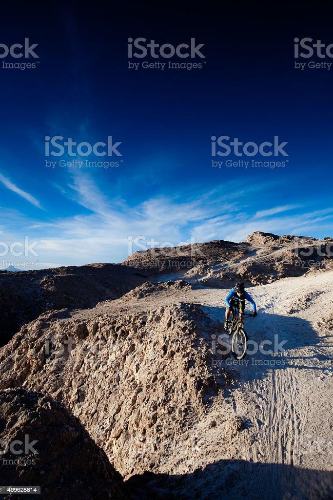 landscape mountain biking man with blue sky stock photo