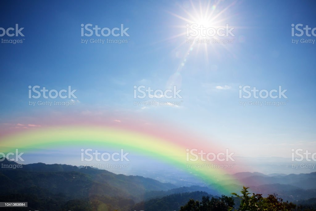 Landscape, mountain hill sun beam and lighting blue sky with rainbow....