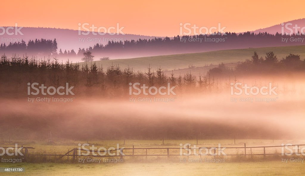 Landscape near Winterberg in the mist, sunrise, spirituality, Sauerland, Germany stock photo