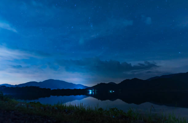 landscape night sky over the lake stock photo