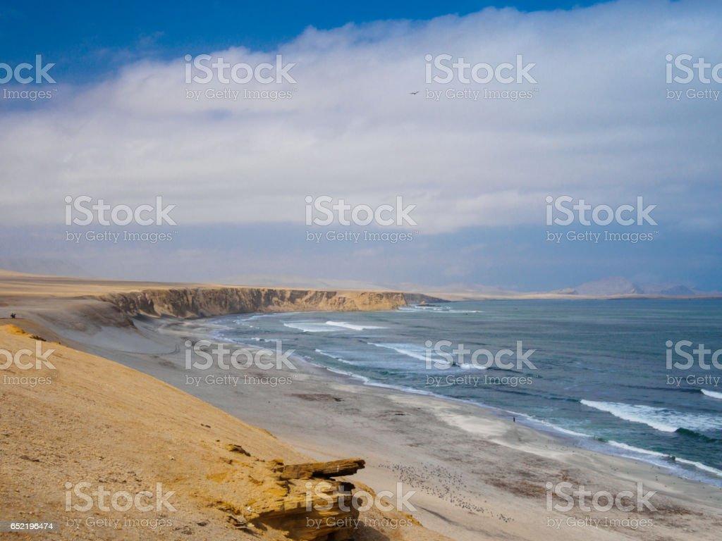 Landscape of a beach and cliffs in Paracas, Peru stock photo