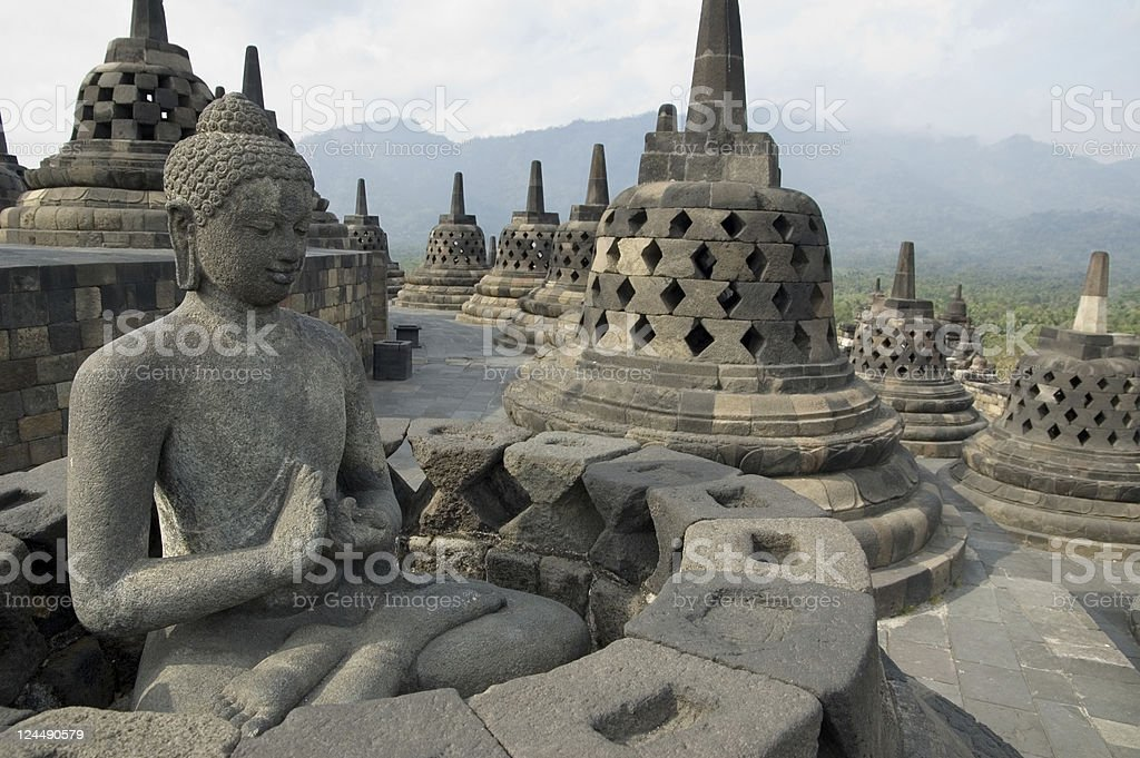 Landscape of a Buddha statue at Borobudur in Java, Indonesia stock photo