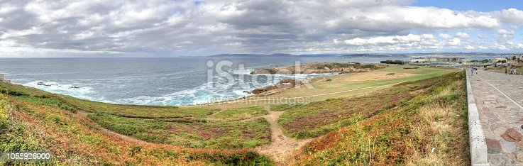 615497916 istock photo A landscape of a cloudy stormy sea and a grass lawn from Tower of Hercules in Galicia capital city La Coruña 1055926000
