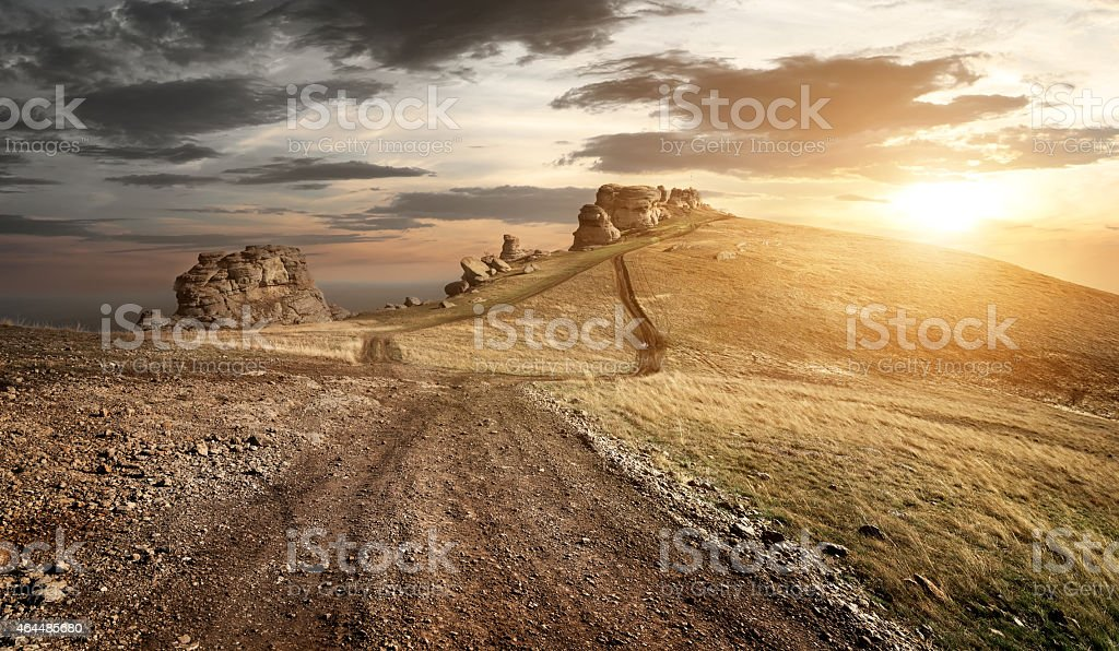 A landscape of a sunset in dry mountains stock photo