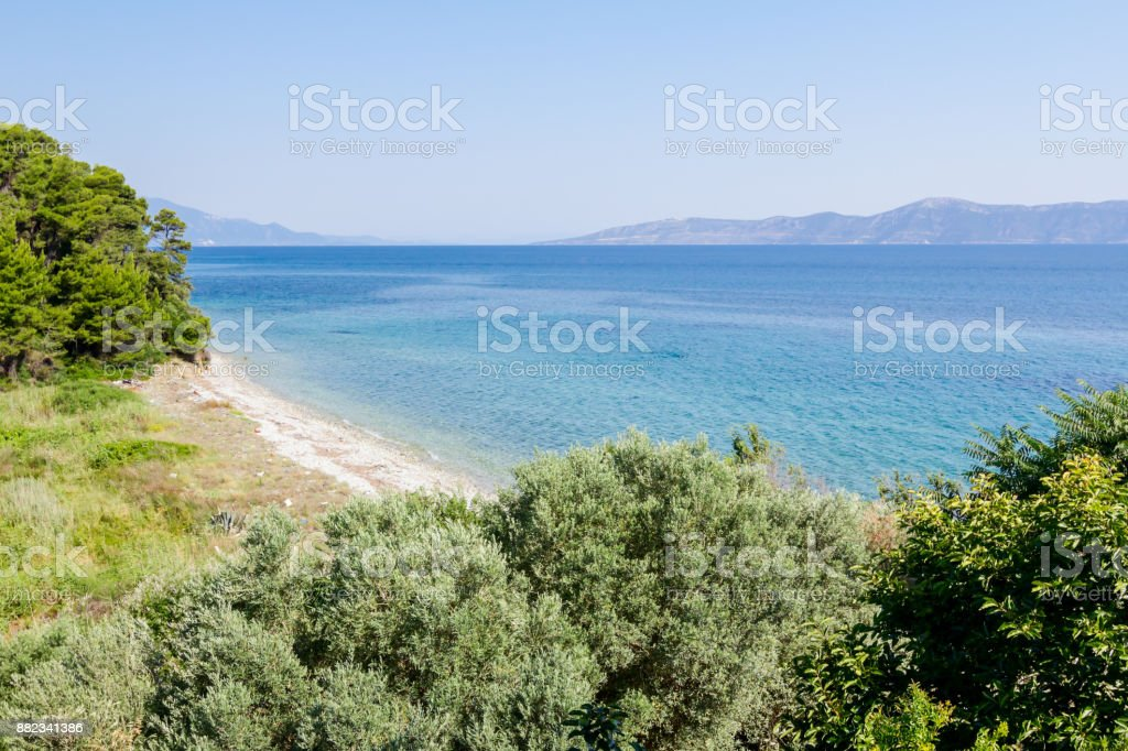 Landscape of bay with open sea and islands in background stock photo