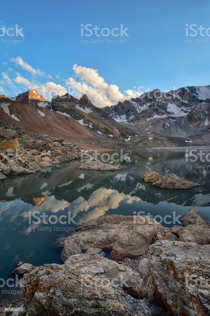 Landscape of beautiful high rocky Fan mountains and lake stock photo