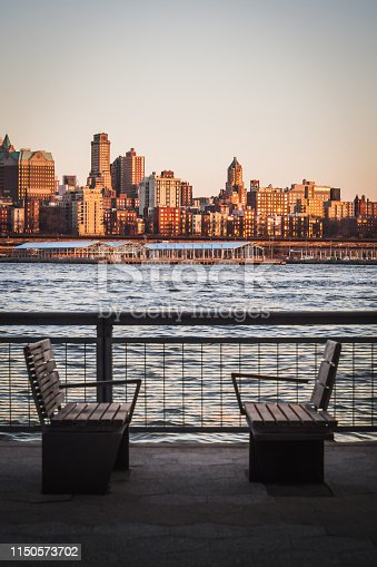 Landscape of benches on the Manhattan Shores Facing Brooklyn Heights Separated by the East River