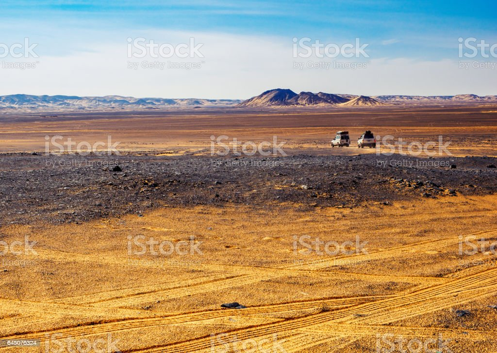 Landscape of Black Desert - safari tour in West Sahara at off-road cars, Egypt. stock photo