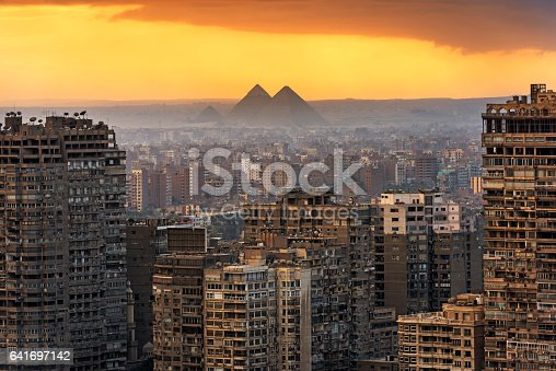Landscape of Cairo,  with the Giza pyramids behind.