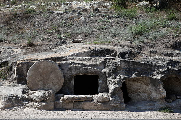 Landscape of Christ's empty stone tune This empty tomb is possibly the tomb that Jesus Christ once used. tomb stock pictures, royalty-free photos & images