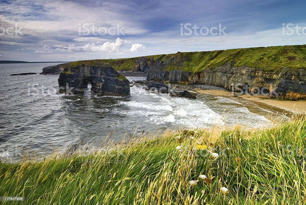 A landscape of cliff and ocean in Ireland stock photo