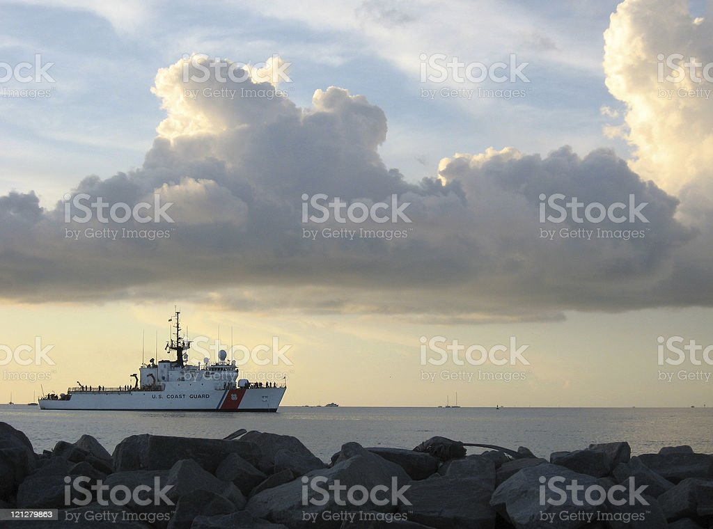 Landscape of coast guard cutter under a cloudy sky royalty-free stock photo