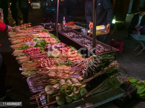 Dali old castle, Yunnan, China - February 22, 2019 : Landscape of bazaar and stalls.