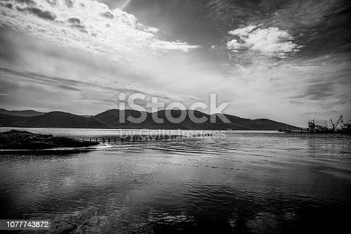 1159605033 istock photo Landscape of dark lake, mountain, cloudy sky and atmosphere. Black and white image. Mugla, Turkey. 1077743872